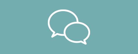 Icône de deux bulles de discussions sur un fond turquoise pastel