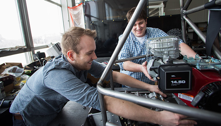 students working on a car prototype
