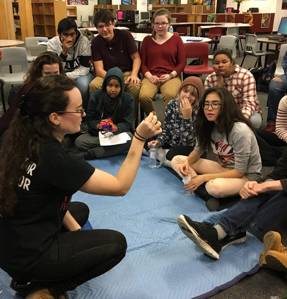 Justine working with students