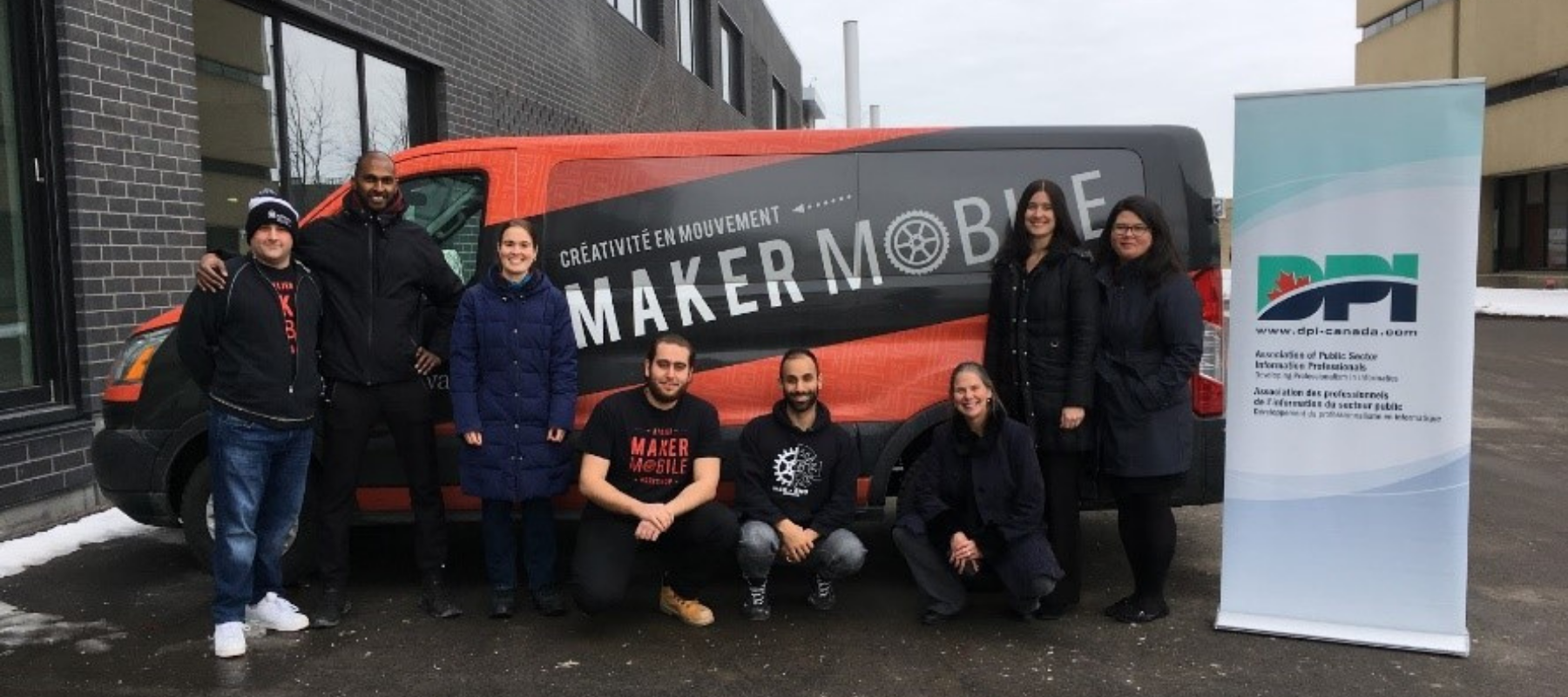 People posing in front of the Makermobile