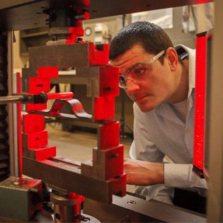 student checking machinery
