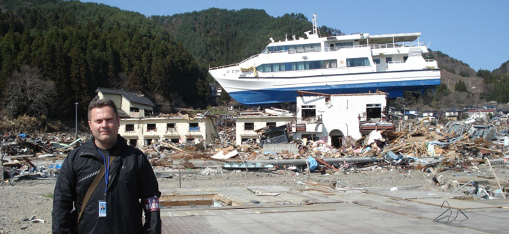 Ioan Nistor poses with infrastructure damaged in 2011 Tohoku tsunami